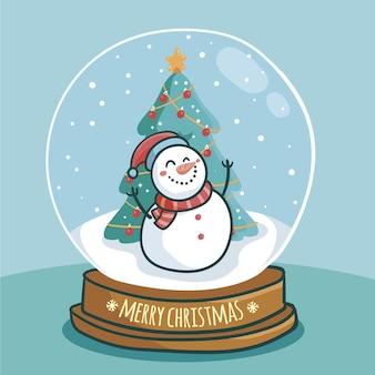 Boule de neige de noël avec bonhomme de neige souriant