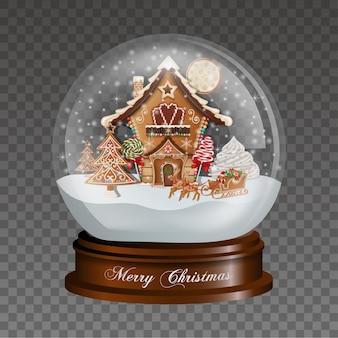 Boule à neige de noël avec maison en pain d'épice et traîneau