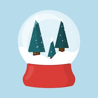 Boule à neige de noël sur un support rouge une boule avec la neige boule à neige avec des arbres de noël