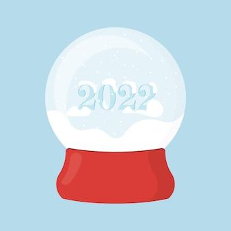 Boule à neige de noël sur un support rouge une boule avec la neige nouvel an 2022