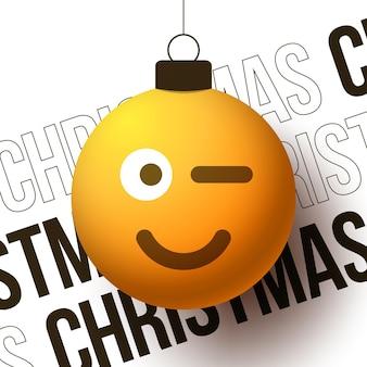 Boule de noël joyeux avec un joli visage souriant emoji clignotant, illustration vectorielle. bonne année ou bannière de carte de voeux de noël