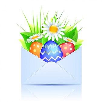 Bouquet de marguerites et oeufs de pâques dans une enveloppe ouverte