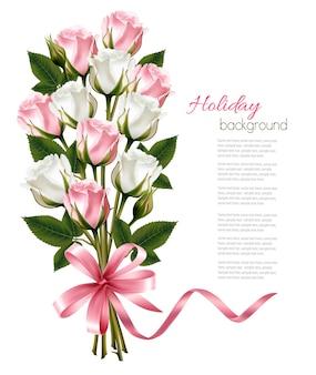 Bouquet de roses roses et blanches et ruban rose.