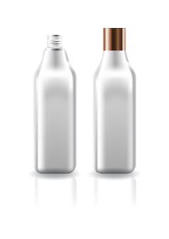 Bouteille carrée claire cosmétique vide avec couvercle à vis en cuivre.