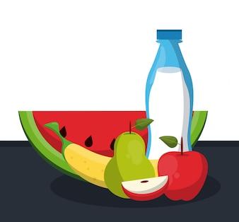 Bouteille de lait avec de délicieux fruits