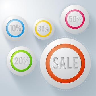 Boutons ronds publicitaires sertis d'inscription de vente et taux de pourcentage de réduction sur gris