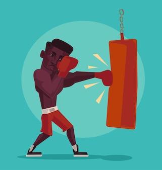 Boxer avec des gants de boxe isolés sur bleu