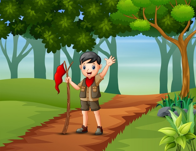 Boy scout randonnée dans le fond de la forêt