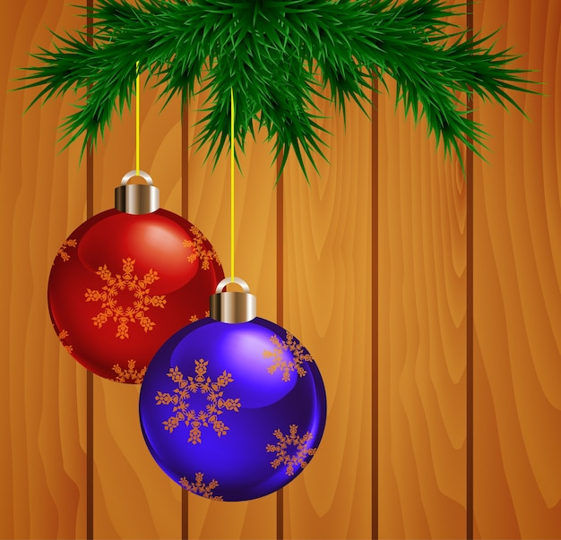 Branches de sapin de noël avec décoration de boules sur planche de bois