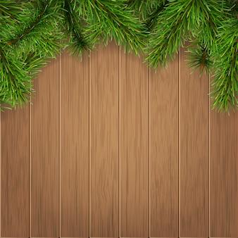 Branches de sapin sur des planches en bois