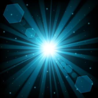 Brillance bleue avec lumière parasite sur fond sombre