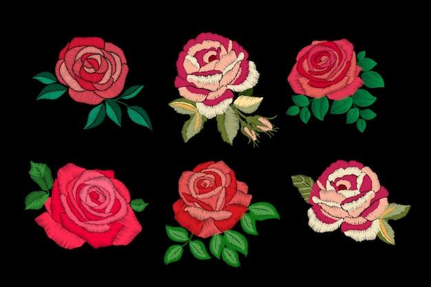 Broderie de roses sur fond noir. collection de roses rouges et roses.