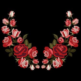 Broderie de roses rouges sur fond noir.