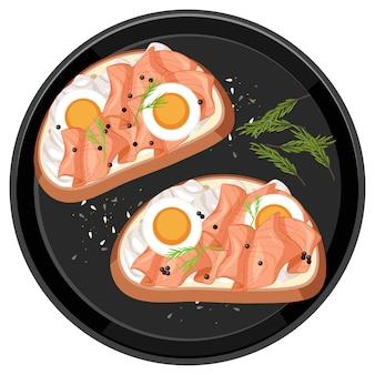Bruschetta au saumon fumé avec garniture aux œufs sur une assiette ronde isolée