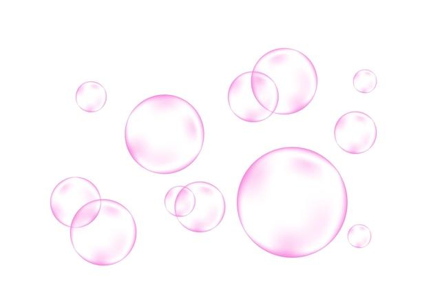 Bulles roses d'air ou d'eau pétillantes sur le blanc