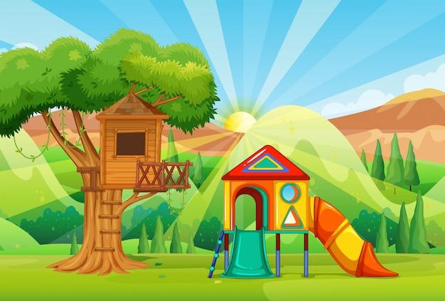 Cabane dans les arbres et toboggans dans le parc
