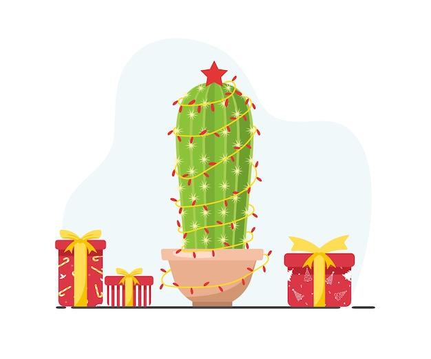 Cactus mignon avec des guirlandes de nouvel an. feliz navidad. joyeux noël.