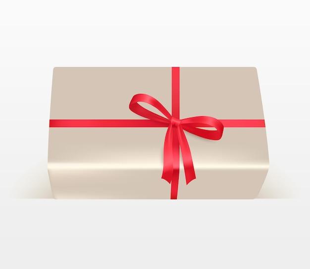 Un cadeau ou un colis, un arc et un ruban rouges