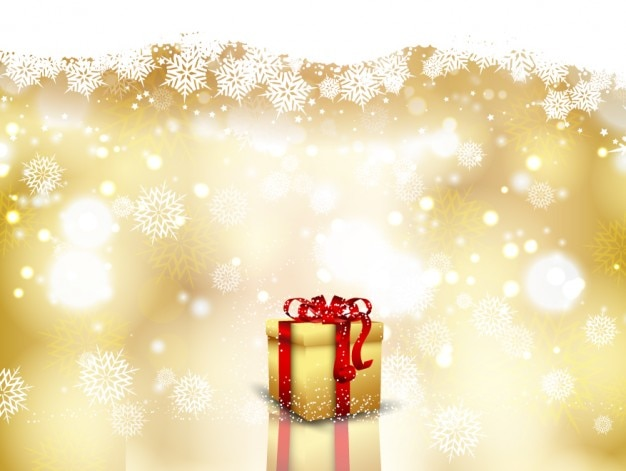 Cadeau sur des flocons de neige fond