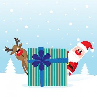 Cadeau avec le père noël et le cerf sur la neige