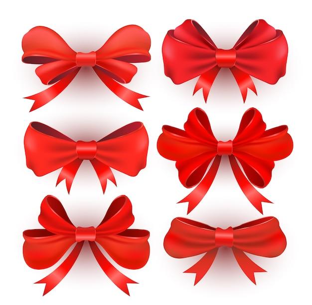 Cadeau rouge s'incline avec des rubans