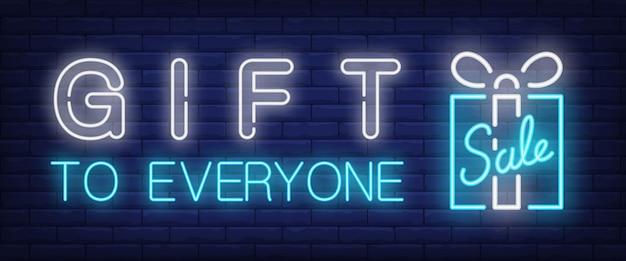 Cadeau à tout le monde, texte néon de vente avec boîte-cadeau