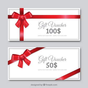 Cadeaux réductions blanches avec un arc rouge