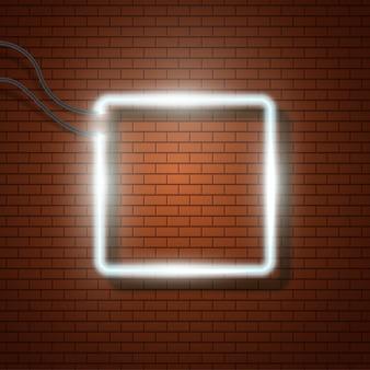 Cadre au néon sur fond de mur de briques