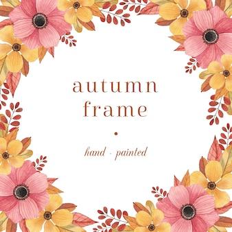 Cadre automne coloré avec des fleurs et des feuilles à l'aquarelle