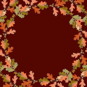 Cadre d'automne avec des feuilles de chêne colorées et des glands.