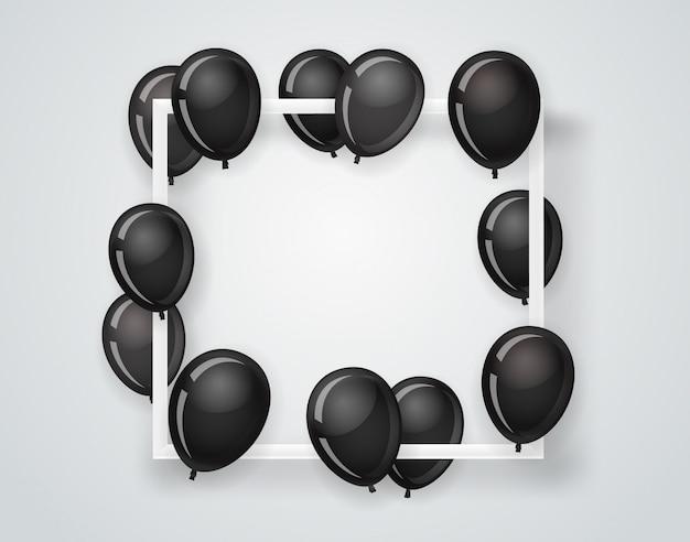 Cadre blanc vide sur un mur avec des ballons noirs volants.