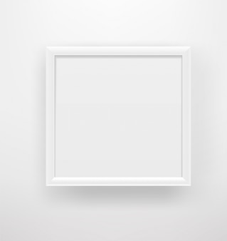 Cadre blanc vide sur un mur blanc