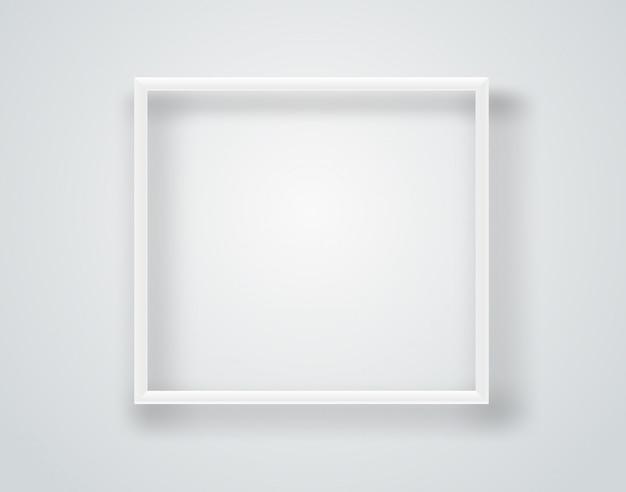 Cadre blanc vide sur un mur.