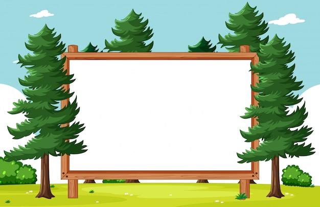 Cadre en bois blanc avec des pins dans la scène du parc