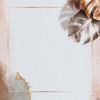 Cadre carré en or avec fond de feuille de monstera métallique