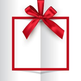 Cadre carré rouge de vacances avec arc et ruban sur fond de livre ouvert blanc.