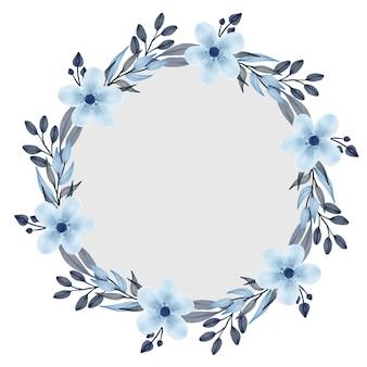 Cadre de cercle de couronne bleue avec une fleur bleue et une bordure de feuille grise