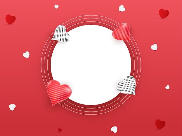 Cadre circulaire blanc vide décoré de coeurs sur fond rouge.