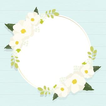 Cadre de couronne de fleurs de cosmos blanc mignon sur carré de fond en bois bleu vintage