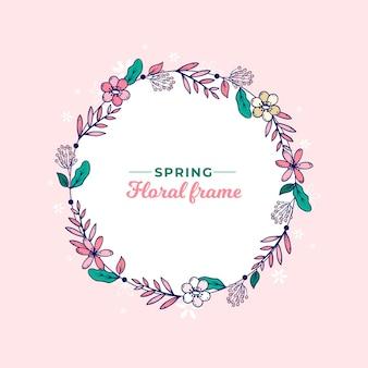 Cadre de couronne florale de printemps dessiné à la main