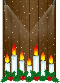 Cadre créatif fait du thème de noël sur le fond en bois avec des bougies de noël