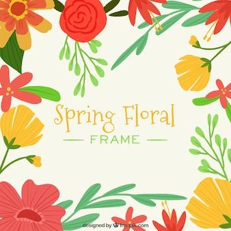 Cadre de printemps floral avec des couleurs chaudes