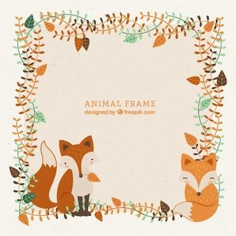 Cadre décoratif avec la main dessinée belles renards et les feuilles
