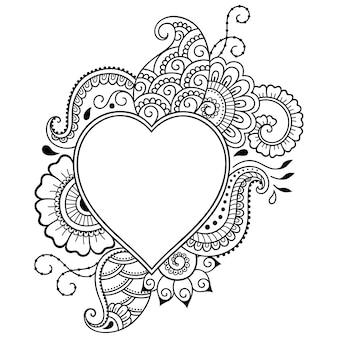 Cadre décoratif avec motif floral en forn de coeur. ornement de doodle en noir et blanc. décrire la main dessiner l'illustration.