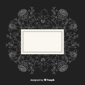 Cadre dessiné à la main avec motif floral sur fond noir