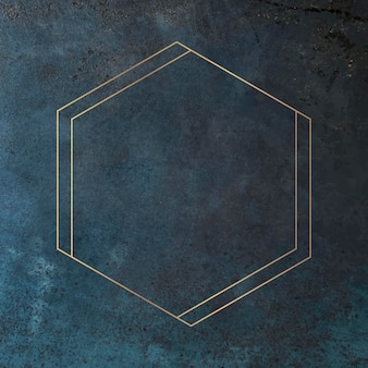 Cadre doré hexagonal sur fond bleu grunge