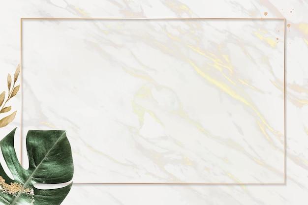 Cadre doré rectangle avec fond de feuille de monstera