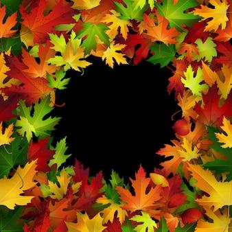 Cadre avec des feuilles d'automne colorées