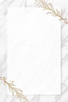 Cadre de feuilles d'or sur fond de marbre