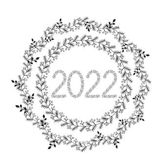 Cadre floral de cercle de couronne de noël dessiné à la main avec des branches bordure de style doodle noir
